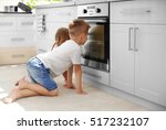 kids playing in kitchen and... | Shutterstock . vector #517232107