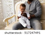 father playing with baby son at ... | Shutterstock . vector #517247491