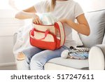 woman packing her bag with... | Shutterstock . vector #517247611