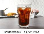 glass of cold coffee on table | Shutterstock . vector #517247965