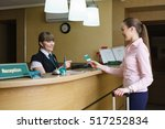 Stock photo hostess and guest communicate with each other 517252834