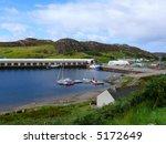 a quaint little harbor with...