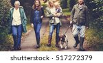 Stock photo family walking dog togetherness nature concept 517272379