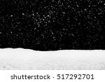 Stock photo snowdrift and flying snow isolated over black winter season 517292701