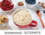scottish porridge oats in red... | Shutterstock . vector #517294975