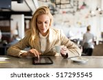 modern business woman in city... | Shutterstock . vector #517295545