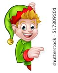 a cute cartoon christmas elf... | Shutterstock .eps vector #517309201