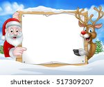 a happy christmas reindeer and... | Shutterstock .eps vector #517309207