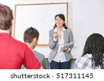 teacher points a student with... | Shutterstock . vector #517311145
