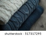 Three Folded Sweaters White An...