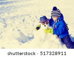 Little Boy With Snowman In...