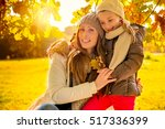 mother with daughter in the... | Shutterstock . vector #517336399