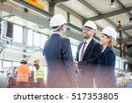 businessmen shaking hands with... | Shutterstock . vector #517353805