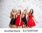 four cheerful beautiful young... | Shutterstock . vector #517359709