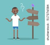 young concerned black man... | Shutterstock .eps vector #517376584