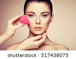 makeup artist applies skintone. ... | Shutterstock . vector #517438075