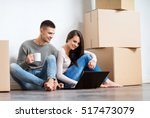 young couple moving in a new... | Shutterstock . vector #517473079