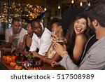 friends having fun at a... | Shutterstock . vector #517508989