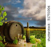 White wine with old wine barrel on background of vineyard landscape - stock photo