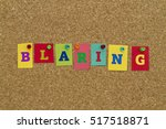 Small photo of Blaring word written on colorful sticky notes pinned on cork board.