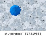 a normal blue umbrella is... | Shutterstock . vector #517519555