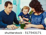 the mother father and son... | Shutterstock . vector #517543171
