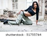 Young woman fashion in ruined building. - stock photo