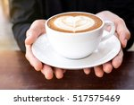 hands holding cup of hot coffee ... | Shutterstock . vector #517575469