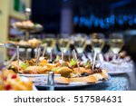 holiday buffet table served by... | Shutterstock . vector #517584631