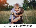 young family with a child have... | Shutterstock . vector #517593349