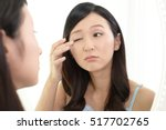 young woman having skin problems   Shutterstock . vector #517702765