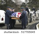 Small photo of Washington DC, Arlington Cemetery - January 26, 2005. Military funeral for WWII retired Air Force officer moving the flag-covered casket to horse drawn caisson for full honors funeral.