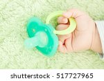 baby's cute little hand and... | Shutterstock . vector #517727965