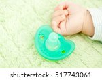baby's cute little hand and... | Shutterstock . vector #517743061