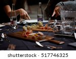 fingers pointing to the meal | Shutterstock . vector #517746325