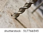 big drill bit in hole of... | Shutterstock . vector #517766545