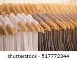 Stock photo white shirts gray shirts and black shirts on clothes line for sale in the market bangkok 517772344
