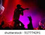 Small photo of MOSCOW-15 NOVEMBER,2016:Famous rap band Asap Mob performing live hip hop music show on nightclub stage.Silhouette of rapping singer with microphone on scene.Rapper concert in crowded music hall