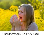 Sensitive Blond Woman Sneezing...