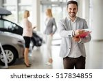 salesperson at car dealership... | Shutterstock . vector #517834855