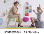 angry young boy sitting on a... | Shutterstock . vector #517839817