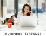 beautiful brunette using laptop ... | Shutterstock . vector #517840219