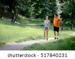 couple jogging and running... | Shutterstock . vector #517840231