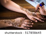 woman mehendi artist painting... | Shutterstock . vector #517858645