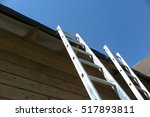 Two Ladders At The Roof Of The...