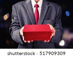 Business Man Hold Red Gift Box