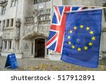 eu and union jack flags flying... | Shutterstock . vector #517912891