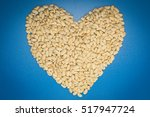white beans in heart shape on... | Shutterstock . vector #517947724