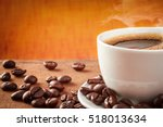 coffee cup on a wooden table... | Shutterstock . vector #518013634