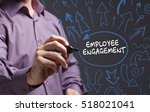 Small photo of Technology, internet, business and marketing. Young business man writing word: employee engagement